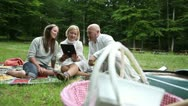 Stock Video Footage of three friends in park with digital tablet