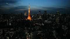 Illuminated Aerial View Tokyo Tower Japan, Zeppelin at dusk over Tokyo Skyline Stock Footage