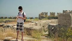 Young teenager sightseeing ancient wals HD Stock Footage