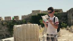 Young teenager sightseeing ancient wals HD - stock footage