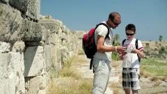 Father with teenage son sightseeing ancient wals HD - stock footage