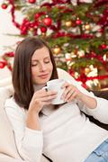 brown hair woman relaxing with coffee on christmas - stock photo