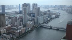 Aerial View Tokyo Residential Skyline, Sumida River, Kachidoki, Rainbow Bridge Stock Footage