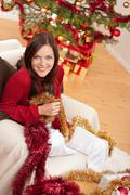 Stock Photo of attractive young woman with christmas decoration