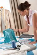 female fashion designer working at studio - stock photo