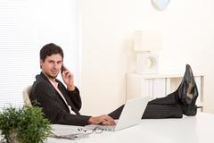 Stock Photo of successful businessman on the phone