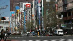 City Shinjuku Neon Street Tokyo Japan Yasukuni Dori Busy People Passing Traffic Stock Footage