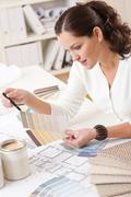 young female interior designer working at office - stock photo