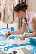 Professional tailor working with fashion sketches Stock Photos