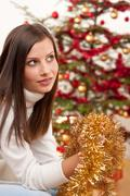 young woman with christmas decoration - stock photo