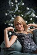 provocative woman posing in gray dress - stock photo