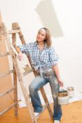 home improvement: smiling woman with paint - stock photo