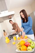 happy couple preparing food together - stock photo