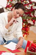 Stock Photo of attractive brunette writing christmas cards