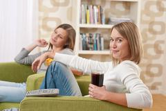 students - two female teenager watching television - stock photo