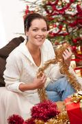 attractive young woman with christmas decoration - stock photo
