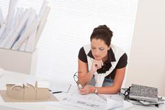 Young female architect with plans Stock Photos