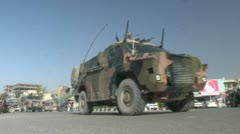 ISAF Bushmasters driving in the streets of Kabul Afghanistan - stock footage