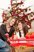 Stock Photo of two women packing christmas present