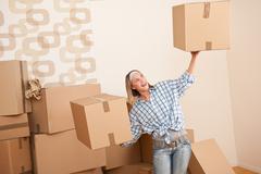 moving house: woman holding big carton box - stock photo
