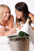 Two young women toasting with champagne Stock Photos
