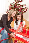 two woman packing christmas present - stock photo