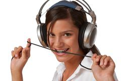 smiling teenager with headphones listening to music - stock photo