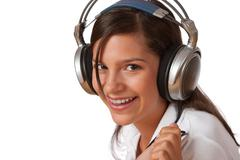 smiling teenager with headphones - stock photo
