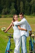 Stock Photo of romantic young couple with old bike in spring nature