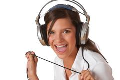 Smiling teenager with headphones listening to music Stock Photos