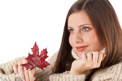 autumn portrait of beautiful woman with leaf wearing turtleneck - stock photo
