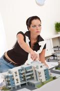young female architect with architectural model - stock photo