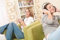students - two female teenager relaxing in lounge - stock photo