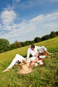 Stock Photo of picnic - romantic couple in spring nature