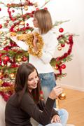 Stock Photo of two smiling women with christmas decoration