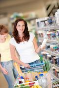 shopping series - brown hair woman with cart - stock photo