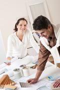 two interior designer working at office with color swatch - stock photo