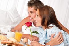 young couple having luxury hotel breakfast - stock photo