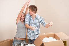 Moving house: man and woman having fun Stock Photos