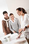 Female interior designer with two clients at office Stock Photos