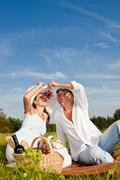 picnic - romantic couple in spring nature - stock photo