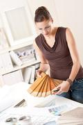 young female designer with wooden color swatches - stock photo
