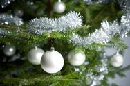 Silver decorated christmas tree with balls and chains Stock Photos