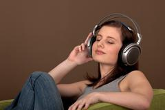 Student series - beautiful brown hair woman with headphones Stock Photos