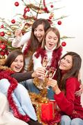 Four young woman toasting with champagne on christmas Stock Photos