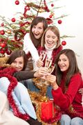 Four young woman on christmas with champagne Stock Photos