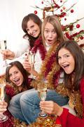 four young woman having fun on christmas - stock photo