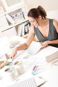 female interior designer working with color swatch - stock photo