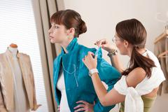 Stock Photo of model fitting by female fashion designer