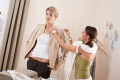 Fashion model fitting clothes by professional designer Stock Photos